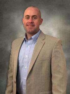 Dr. Adam Aldridge, Principal