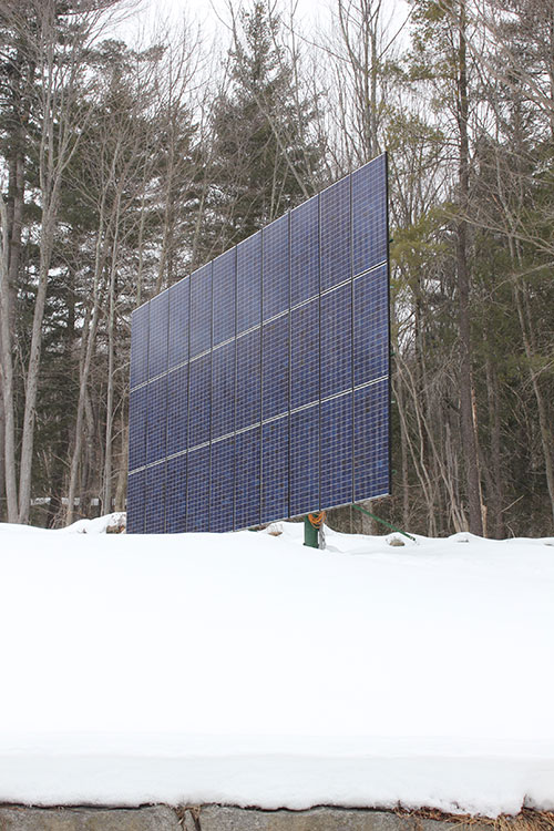 Pole-mounted array set to its winter position.