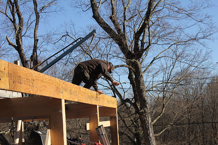 Working on the southeast corner of the solar timber frame building.