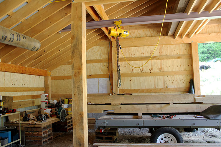 Interior western view of the solar-powered timber frame EV garage.