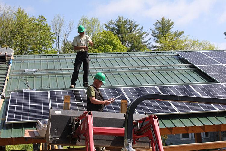 Installing ironridge racking and solar panels.