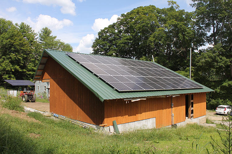 Southwest view of the solar-powered timber frame EV building.