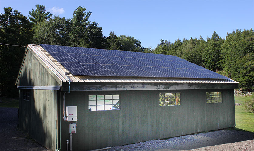 Solar array installed on a garage roof.