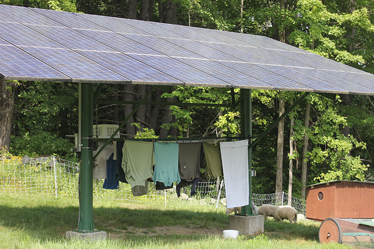 Pole-mounted array rigged with a custom clothes dryer.