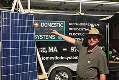 Stefan explaining battery backup systems at the Garlic and Arts Festival in Orange, Massachusetts.