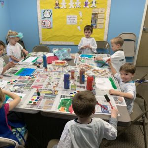 The early elementary class enjoys painting in the Art of Nature class at Learn Together Lowcountry homeschool co-op in Bluffton SC