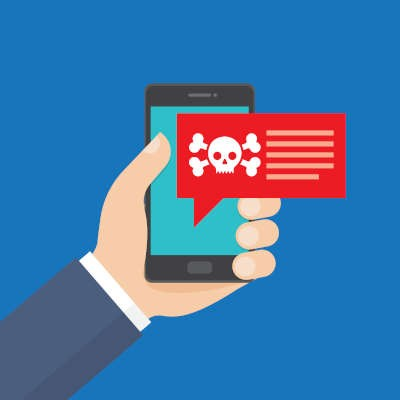 A cartoon hand holds a cartoon iphone with a red speech pop up bubble inside containing a skull and crossbones