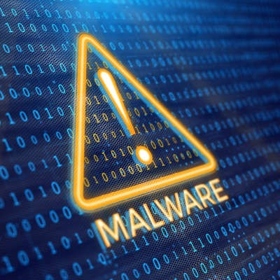 The outline of a yellow triangle with an exclamation point in the center sits in the middle of a dotted dark blue background. Under the triangle is the word malware.