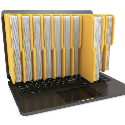 Full yellow file folders appear to be sticking out of a laptop screen
