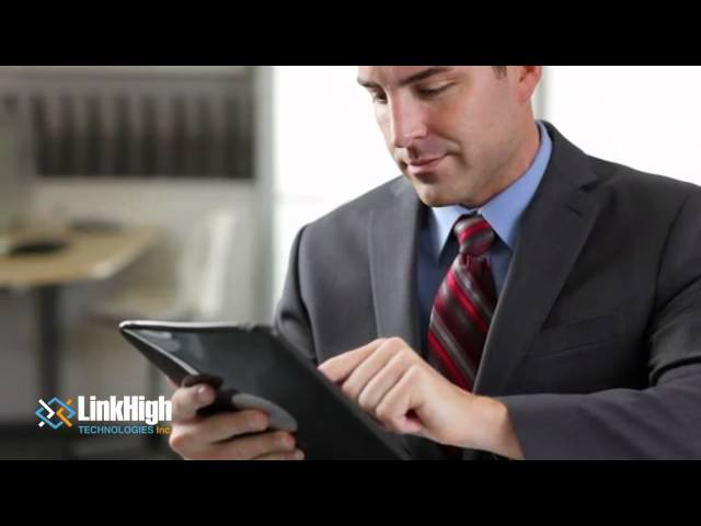 Video Image: Link High Technologies, businessman typing on iPad