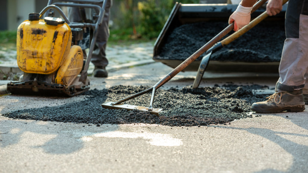 low angle view, workers asphalt concrete