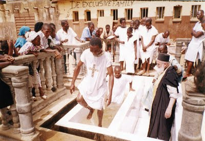 Fr. Themi baptizing in Sierra Leone