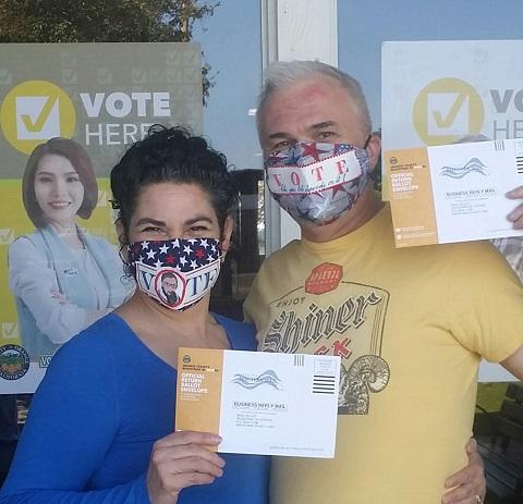 Carmen Uriarte and Wraub voting in masks by Phoenix Raising Art
