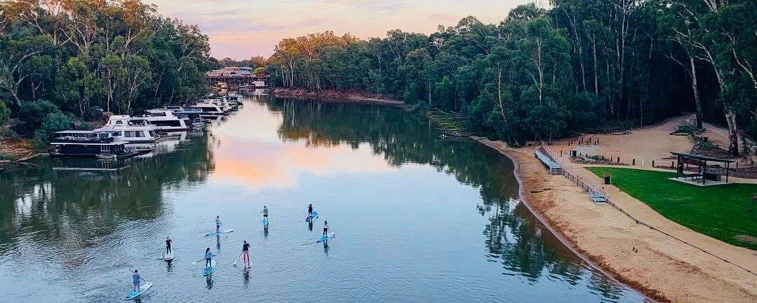 stand up paddle boarding drone shot