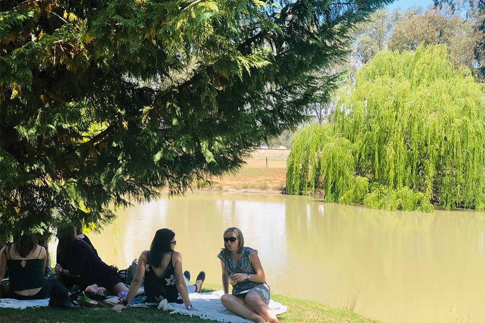 sitting by lake at perricoota vines