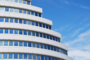 modern office building against blue sky background