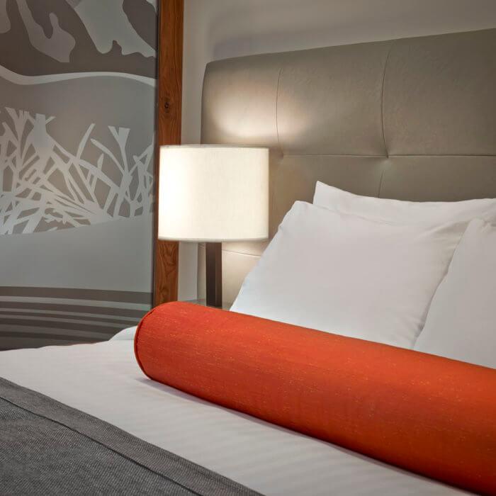 Best Western Hotel Interior Design Bed Orange Bolster Lamp