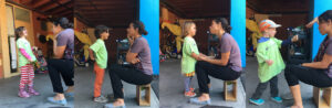 Four students interacting with teacher