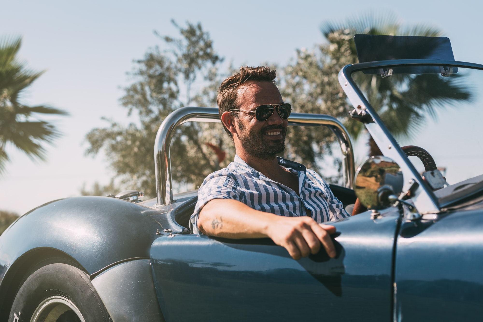 Man driving a convertible vintage car
