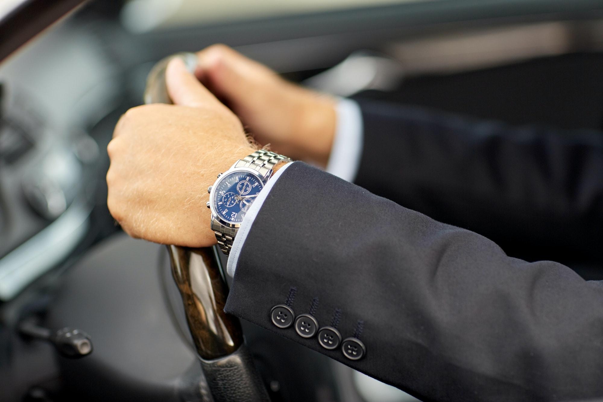 senior businessman hands driving car