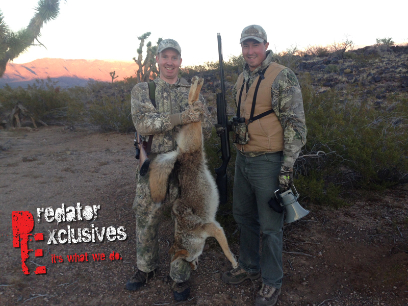 Ian holding the biggest coyote of the guided predator hunting trip in Arizona.