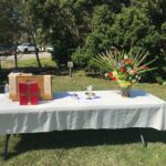 Outdoor Altar setting with bible and flowers at St Thomas Episcopal Church Bath NC
