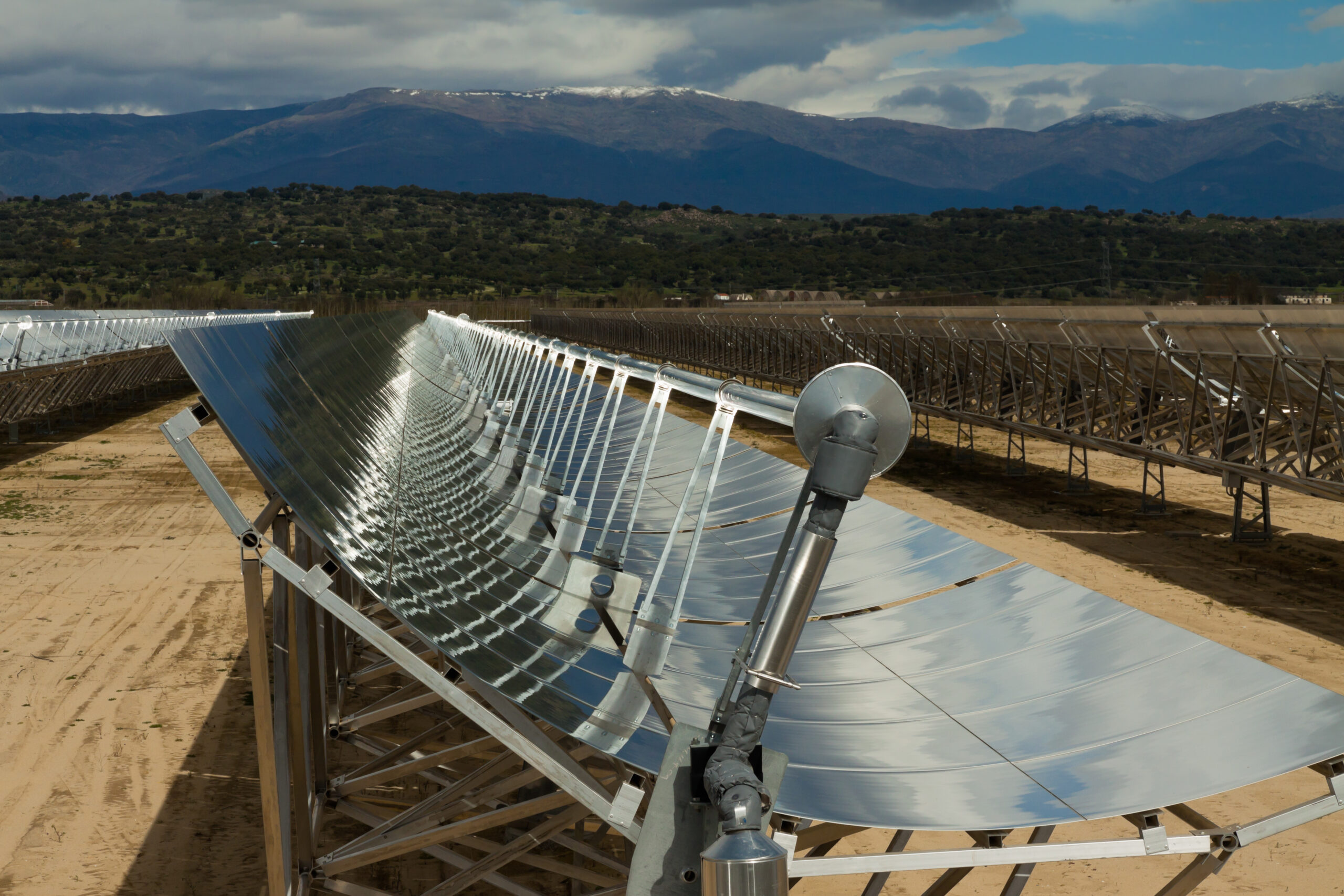 A parabolic trough collector directing solar energy to generate CSP.