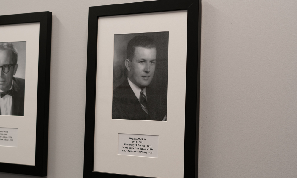 Coolidge Wall founders framed photos on white wall