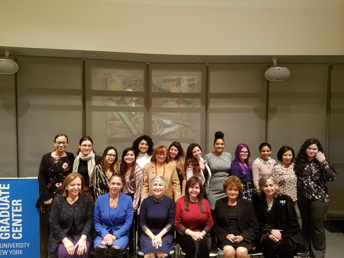 A group photo of women in a panel