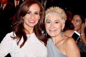 Two beautiful women attending the gala