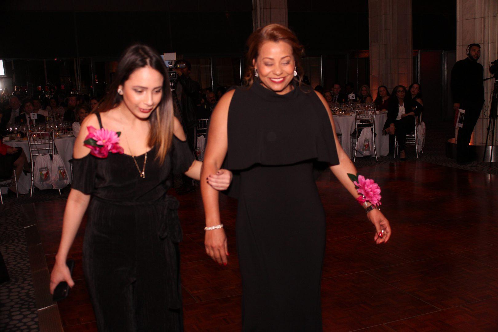 Two women in black dresses