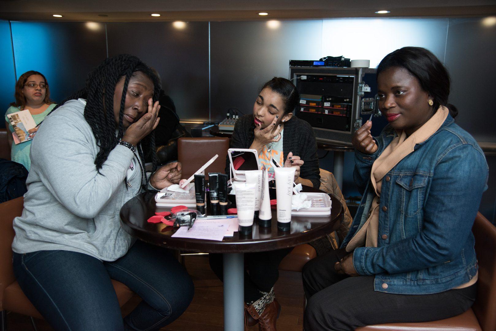 Women putting on makeup