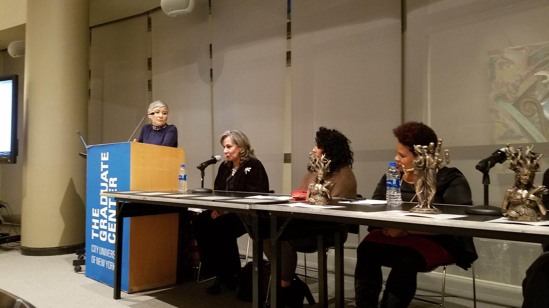 Women speaking as a panel