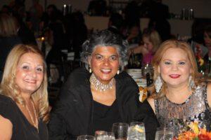 Three women attending the gala night