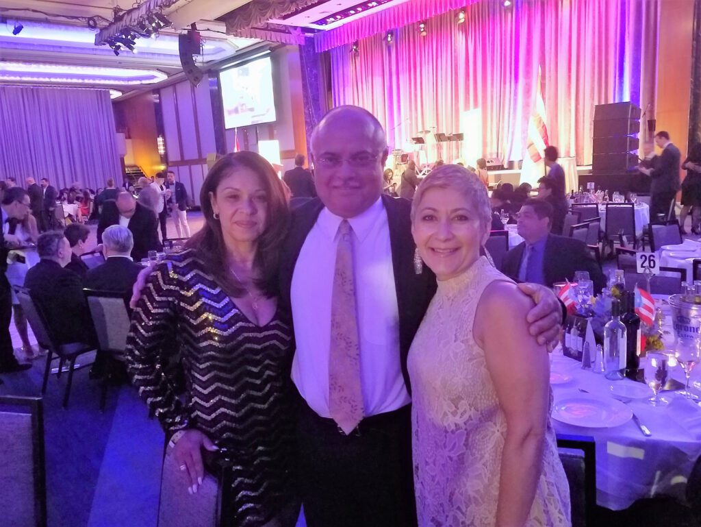 A man and two women during the Puertorican Day Parade Gala 16'