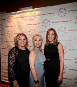 Three women attending the inspiration night gala