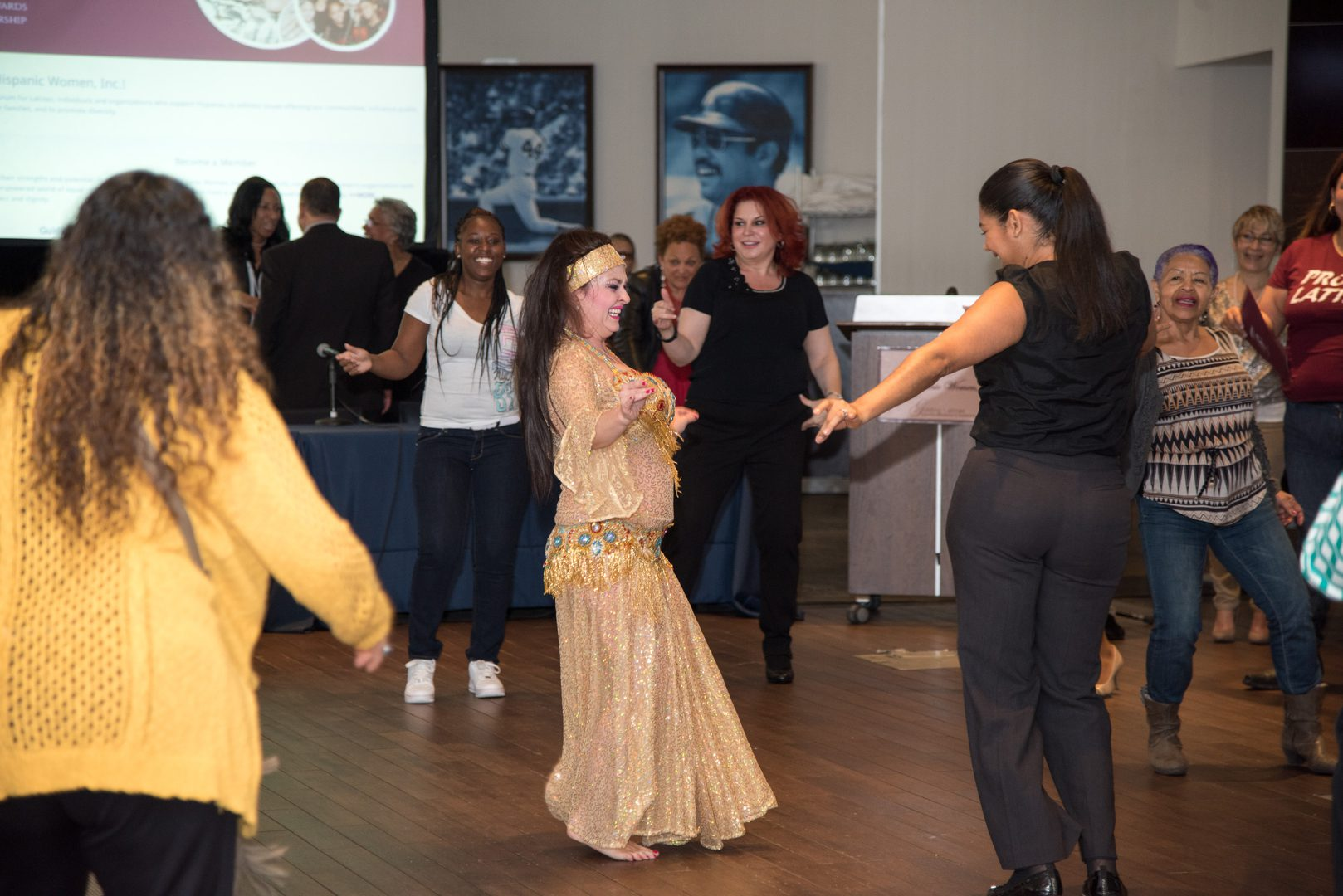 A woman dancing along with the instructor