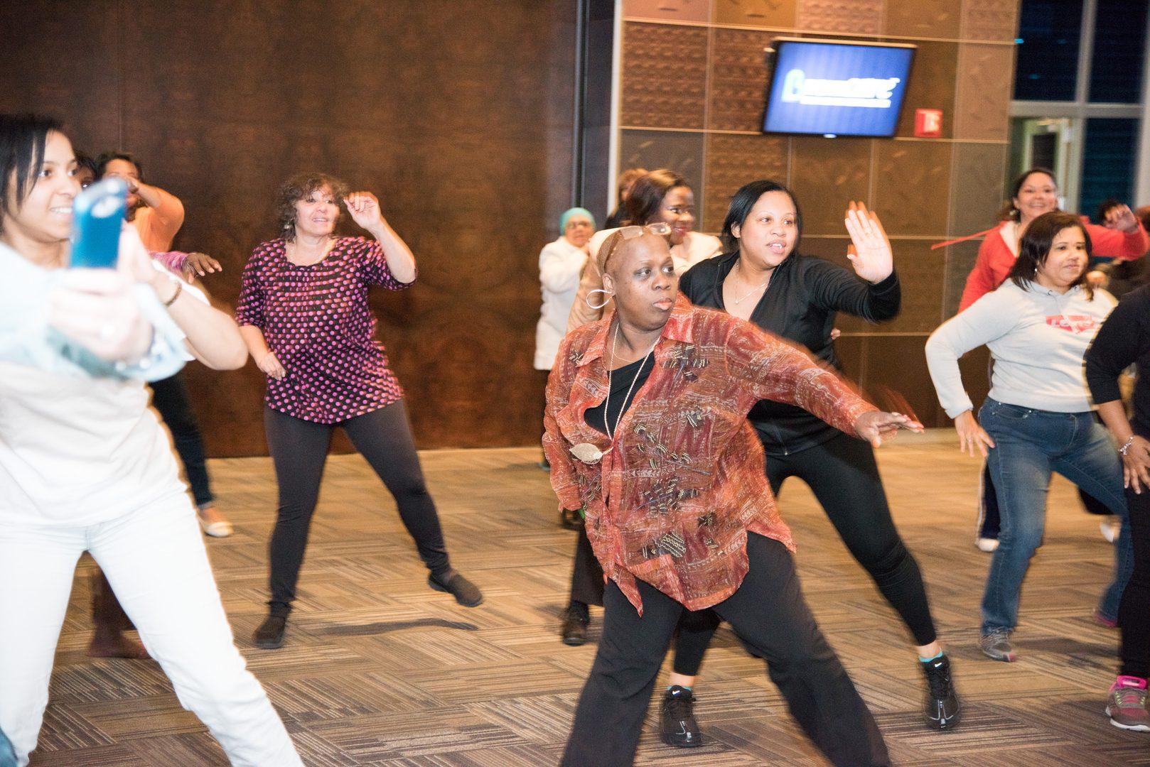 Women following dance moves