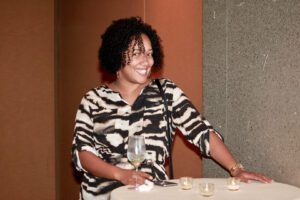 A happy black woman in stripes
