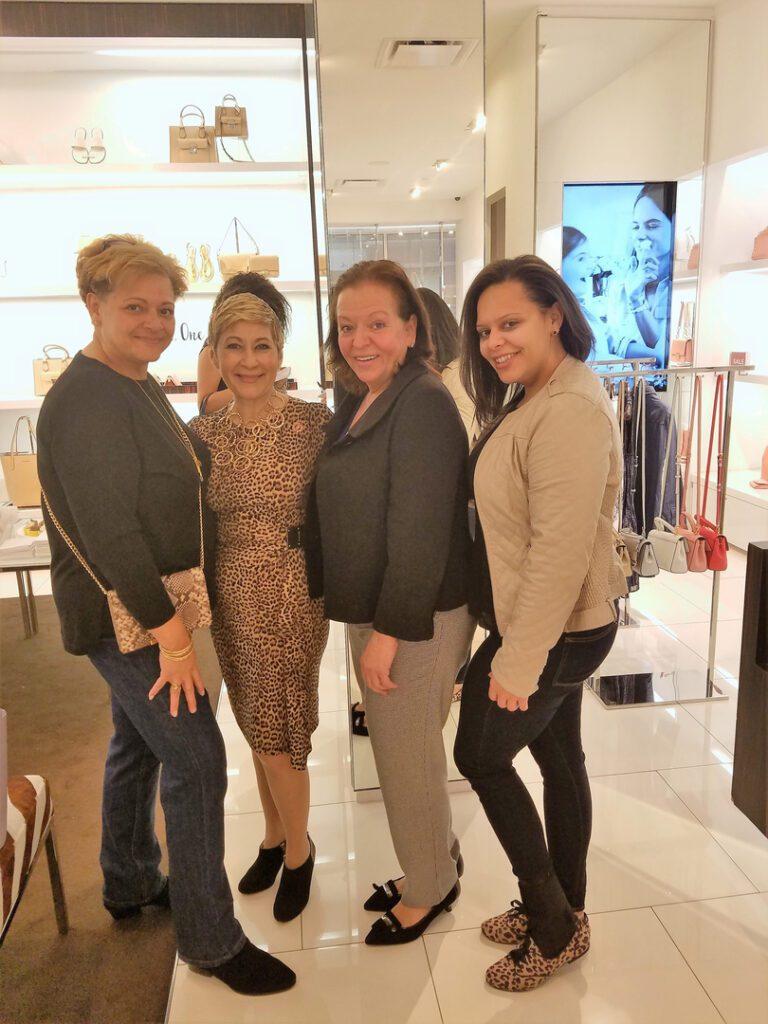 Three women posing with Nancy