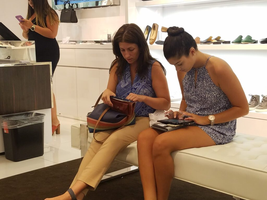Two women using their gadgets