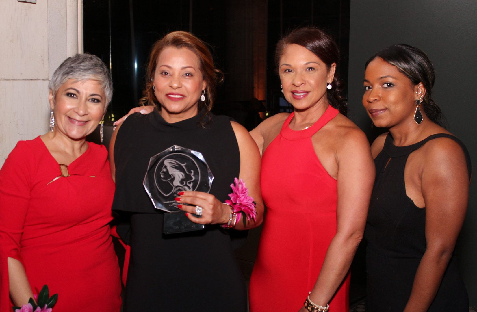 A group of women in elegant dressses