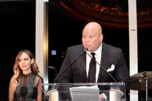 A man speaking at a podium