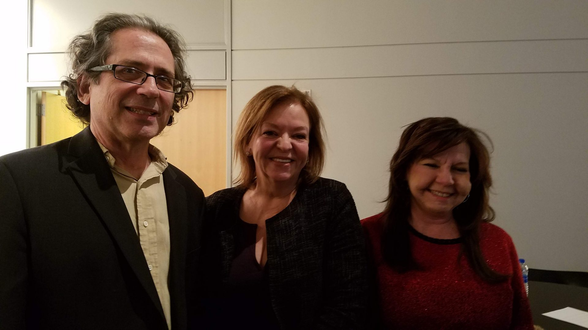 Three people smiling