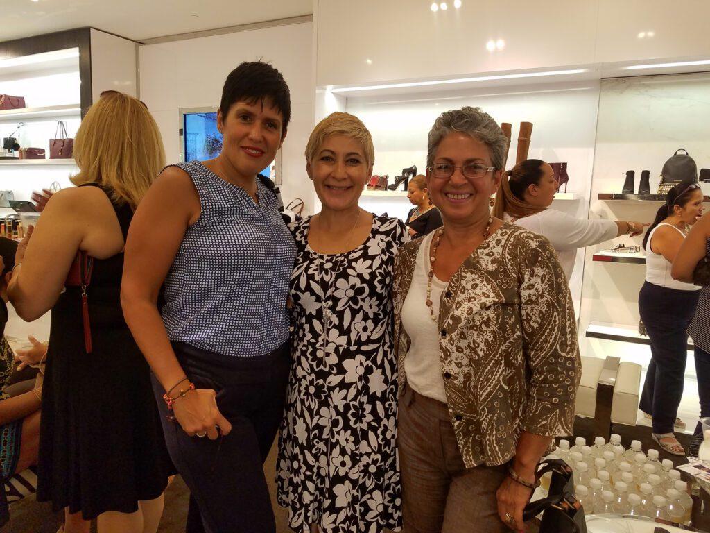 Three women in the fashion store