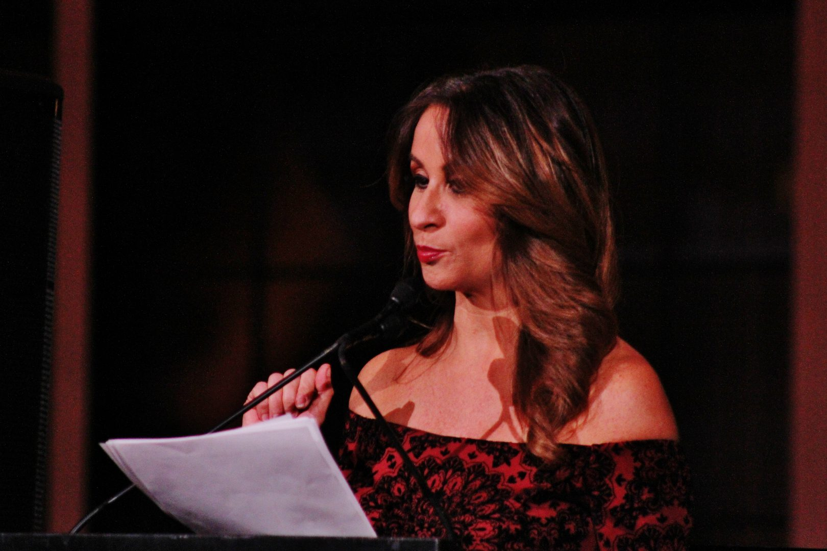 A woman talking on stage