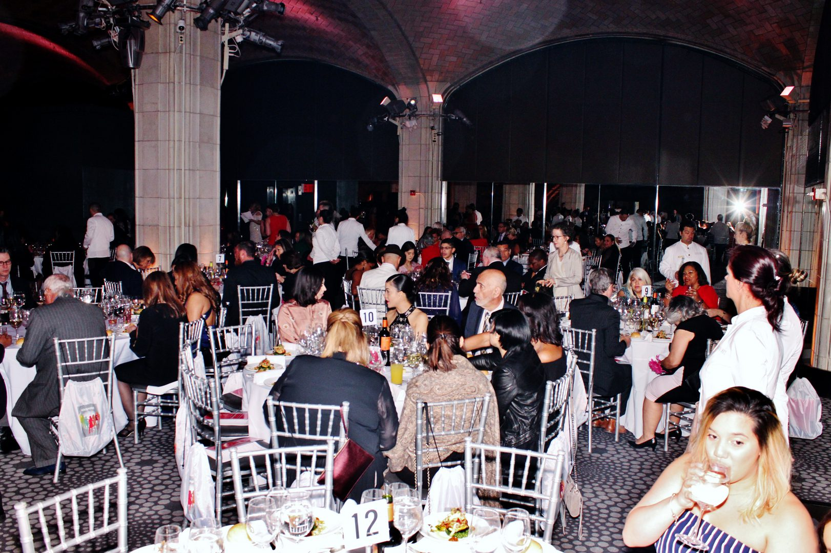 A crowd eating at an event