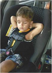 Child sleeping in car seat
