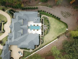 Overhead view of mansion and pool