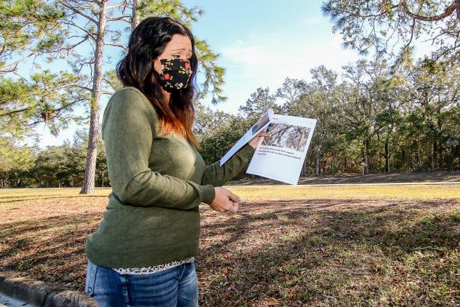 Gulf Breeze resident Abbey Rodamaker holds her petition